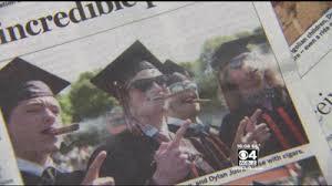 Cigar Smoking at Graduation