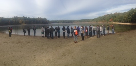 Students stand in front of Walden Pond, Concord, MA.