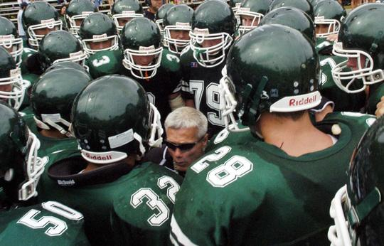 West Newbury: Pentucket's head coach Steve Hayden huddles with his players as they get ready for the 2nd half action. North Reading Football team defeted Pentucket High School 8-6. Photo by Tim Jean/Eagle-Tribune Saturday, September 06, 2008