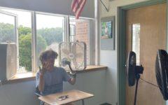 (Photo Source: Isabella Digennaro) Luke Redgate battling the heat in Ms. Ducolon's classroom